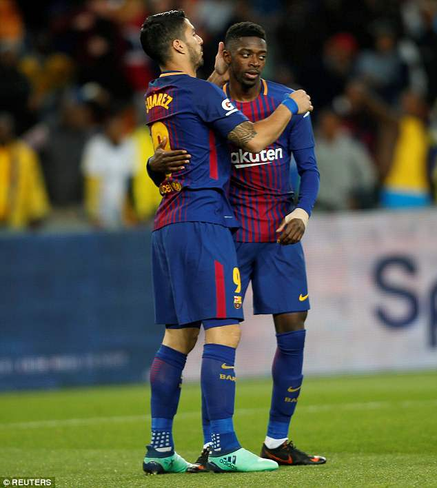 Luis Suarez congratulates his team-mate for scoring the opening goal on Wednesday evening