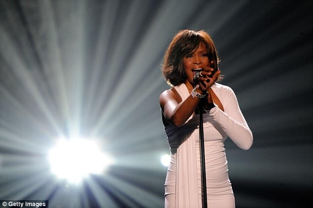 Singer Whitney Houston accepts the Winner of International - Favorite Artist Award onstage at the 2009