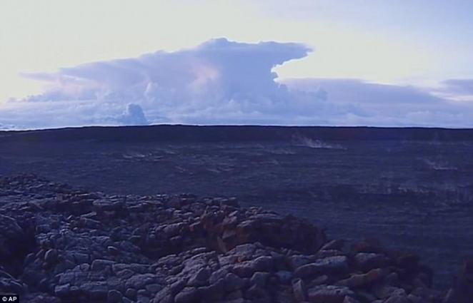An explosive eruption from Hawaii's Kilauea volcano on Thursday sent ash spewing 30,000 feet into the sky (above), with residents now being warned to shelter in place