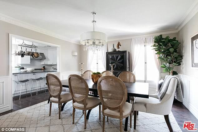 A formal dining room is situated adjacent to the kitchen
