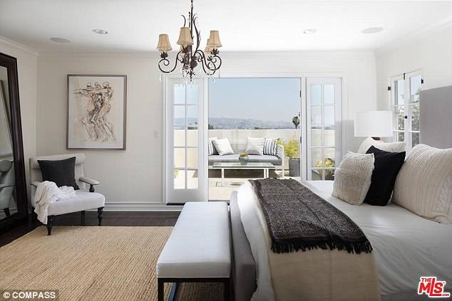 The master suite opens out onto a private terrace