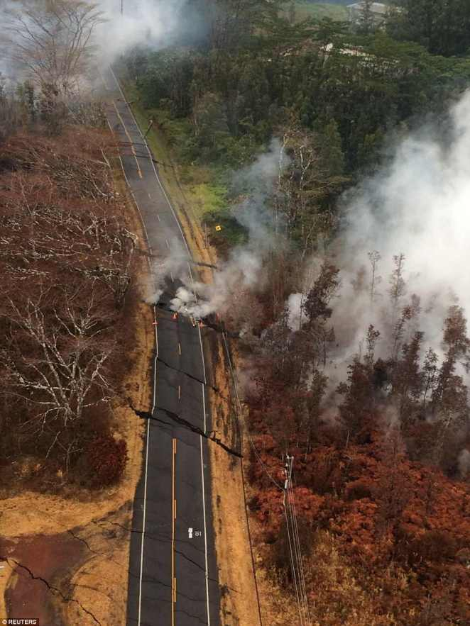 Aerial view of ground cracks on a road during an overflight of the eruptrive fissure area following eruption of Kilauea volcano, Hawaii May 17, 2018