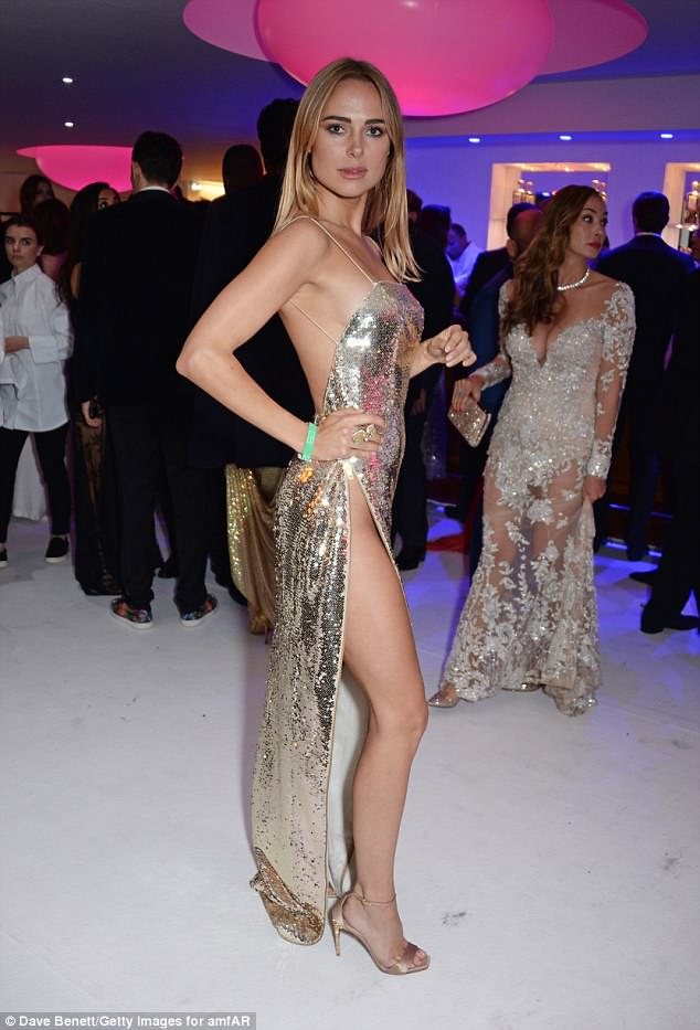 Wow-factor! The swimwear designer, 28, commanded attention as she slipped her incredibly toned figure into a heavily-sequinned gown
