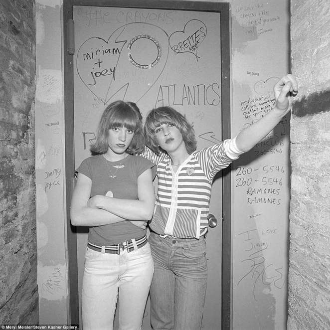 Meisler also said that the 'graffiti was awesome, on the walls because you can see the names of the band members – the Ramones, the Sex Pistols, Jimmy Page, Patti Smith Group and Miriam + Joey with hearts around each other. This was a place that helped launch their careers and made them so well known.' Pictured above are two then-high school students from Brooklyn inside CBGB in 1977; Meisler years later reconnected with the two women above and they are still good friends