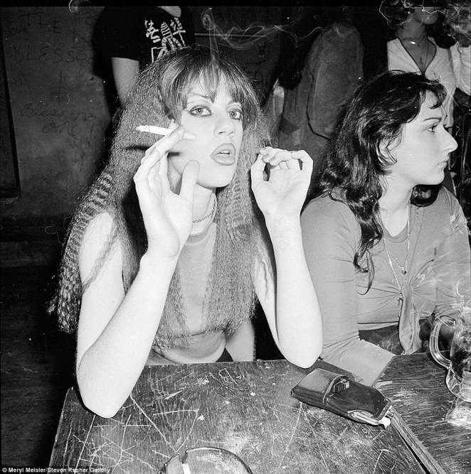 The pop-up exhibition part of Lower East Side History Month aims to 'hark back to a time when living and (life) was cheap and legends were born' according to a press release from the gallery. Pictured above is a woman smoking inside CBGB in 1978