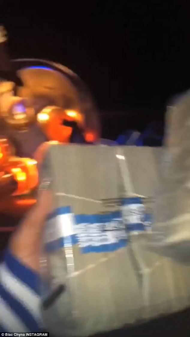 At the club: The second video displayed multiple strippers dancing and a floor littered with cash