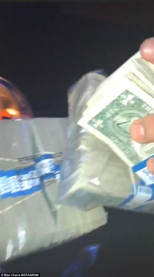 Mourning: The first clip showed the 30-year-old model with large stacks of one dollar bills in her hands
