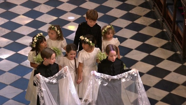 The little girls, including Princess Charlotte, were dressed in all white and had flowers adorning their hair as they followed behind Meghan Markle as she walked down the aisle