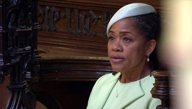 Doria Ragland appeared overcome with emotion as she took her pew in St George's Chapel ahead of her daughter's arrival