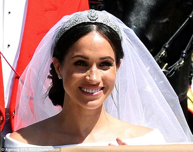 Royal fans defend Meghan's 'beautiful' wedding hair as her messy bun is criticized for coming 'undone'