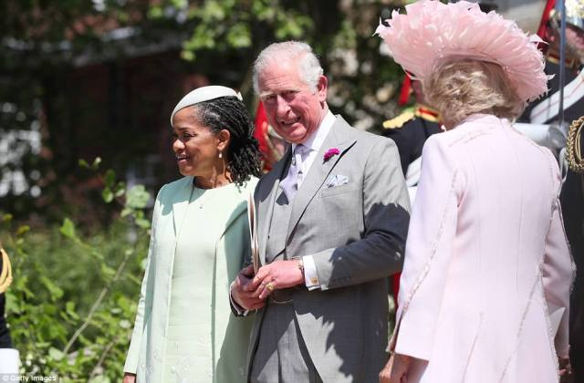 Neither Charles nor Doria could wipe the smiles off their faces having just seen their children get married