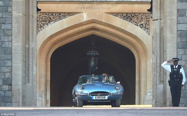 Harry drives his new wife out of Windsor Castle on their way to the evening reception at Frogmore House
