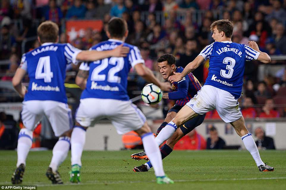 Philippe Coutinho gives Barcelona the lead with a brilliant curling effort from just outside the box in the second half