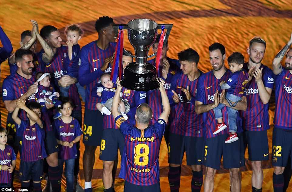 Given the responsibility of holding the La Liga trophy, Iniesta's career ended with a defeat and a night of huge celebrations
