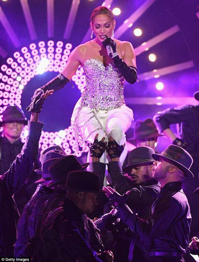 Raise the roof! At the Billboard Awards earlier that night, J-Lo flaunted her chiseled figure in a glittering off-the-shoulder top as her backup dancers lifted her dramatically into the air