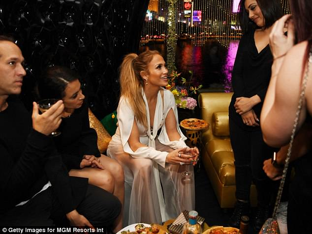 Catching up: Jennifer caught up with her friends and family over some nibbles at the event