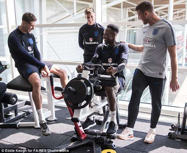 Danny Welbeck chats with John Stones and Mason Mount in a gym session at St George's Park