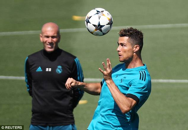 Under the watchful eye of manager Zinedine Zidane, Ronaldo jumps for a header on the pitch