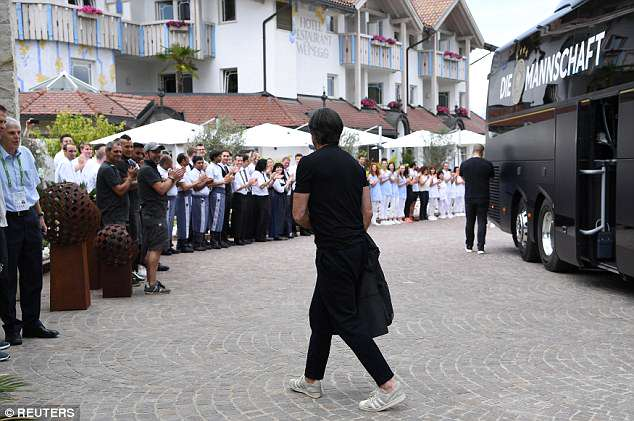 Germany boss Joachim Low is welcomed by hotel staff on arrival at their accommodation