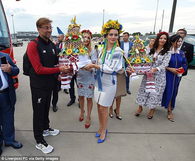 The Liverpool manager was handed traditional Ukrainian gifts upon his arrival on Thursday