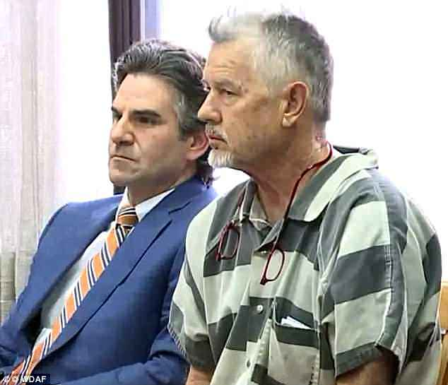 John Schooley is pictured in court in Kansas where he pleaded not guilty to second degree murder over the death of a boy who was decapitated on a slide he designed in 2016