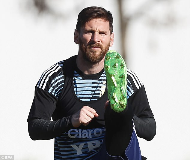 Lionel Messi stretches as Argentina train inEzeiza, Buenos Aires, ahead of the World Cup