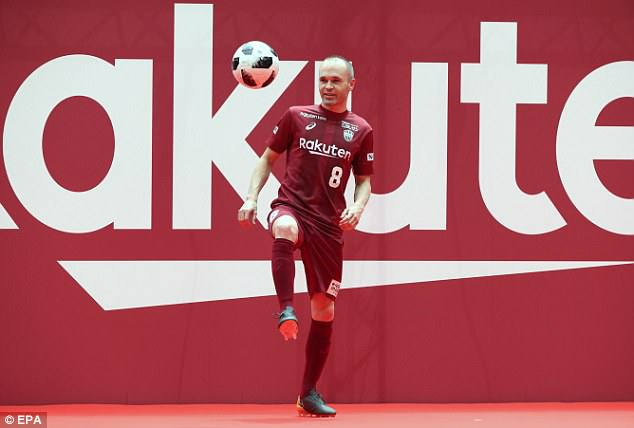 In his full kit, including wearing No 8, Iniesta performed keepy-uppies for the watching crowd