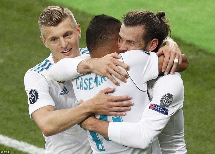 The 28-year-old celebrates his second with Casemiro and Toni Kroos as Madrid won their third straight Champions League