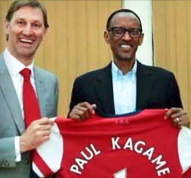 Former Arsenal captain Tony Adams presents a jersey to Ruwandan dictator Paul Kagame in 2014 as she spends £30 in UK aid to sponsor the team
