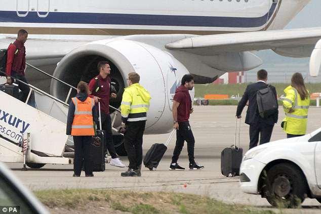 (L-R) Georginio Wijnaldum, Dejan Lovren and Mohamed Salah walk off Liverpool's plane