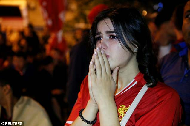 This girl gathers her thoughts outside the stadium in Kiev having witnessed Liverpool's 3-1 defeat to Real Madrid