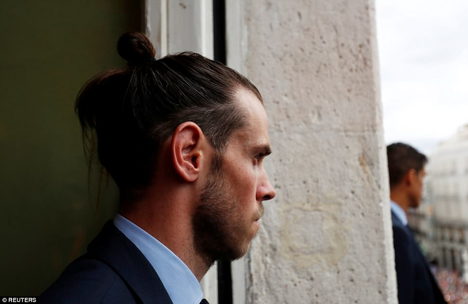 Gareth Bale takes in his surroundings after winning the Champions League for Madrid, scoring twice in  3-1 win vs Liverpool