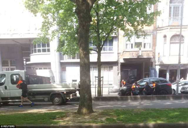 Police officers are seen on the scene of a shooting in Liege, Belgium, in this picture posted on social media by a witness