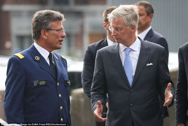 Condolences: Liege police chief C. Beaupierre speak to Belgiums'  King Philippe, who arrived in Liege this afternoon