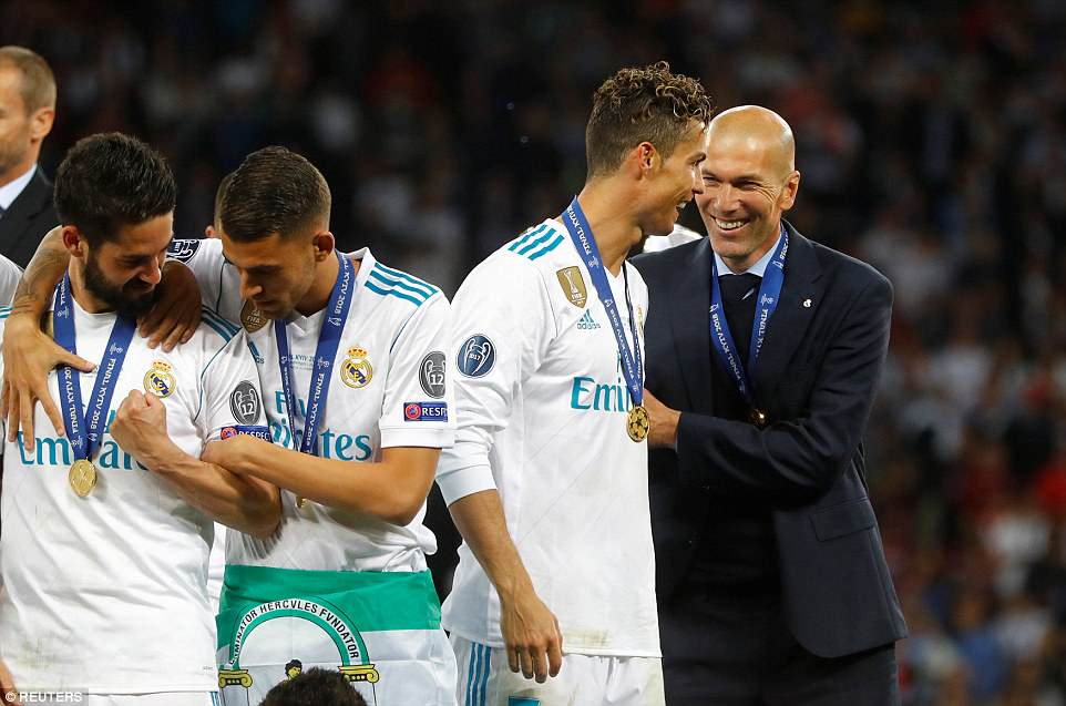 Zidane (R) and Cristiano Ronaldo (C-R) smile following their Champions League success