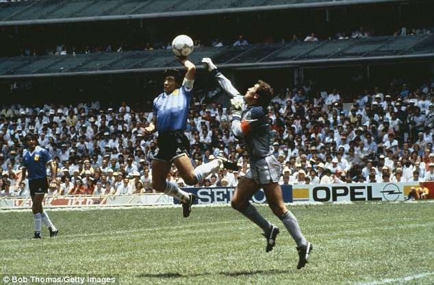 Maradona handles the ball into the net as Peter Shilton tries to punch it clear in Mexico City