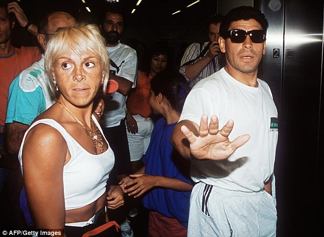 Maradona waves away photographers at the airport after testing positive forephedrine
