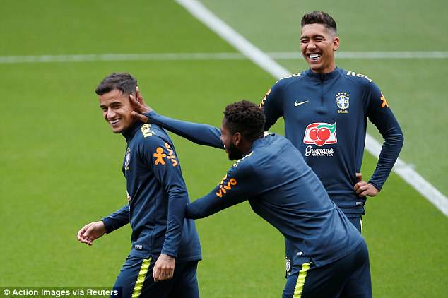 Philippe Coutinho (left) has a laugh with Roberto Firmino (right) and Fred during training