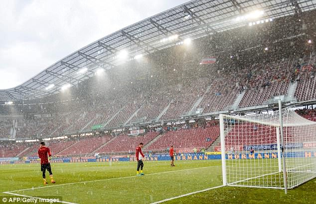 Kick-off was delayed by an hour and three quarters due to heavy rain and hail in Austria