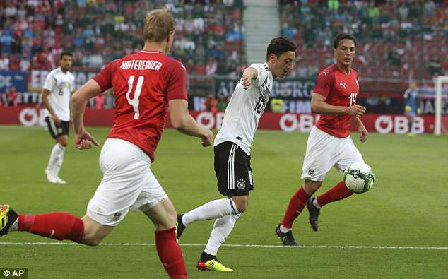 Mesut Ozil gave Germany the lead on 11 minutes in their World Cup warm-up against Austria
