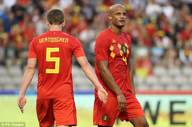 Vincent Kompany (right) picked up a groin injury during the goalless stalemate with Portugal
