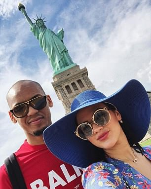 Fabinho posed for a snap with his wife by the Statue of Liberty in New York