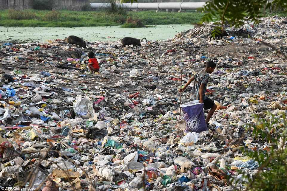 In the rainy season, grimy water from sewers enters homes with families having to cope with the sludge and stench