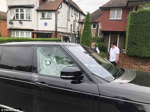 Pictures taken shortly after the attack show the driver's side window smashed and damage to Mr McIntyre's door