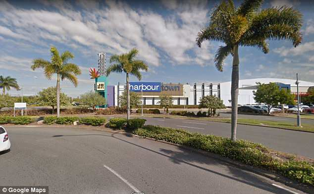 Mr Balanay was arrested after Harbor Town Shopping Centre (pictured) staff caught him filming women and he was ordered to surrender passport and face court June 18