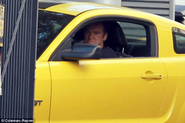 The boss: Tarantino, who turned up in a yellow Mustang, looked downright grumpy