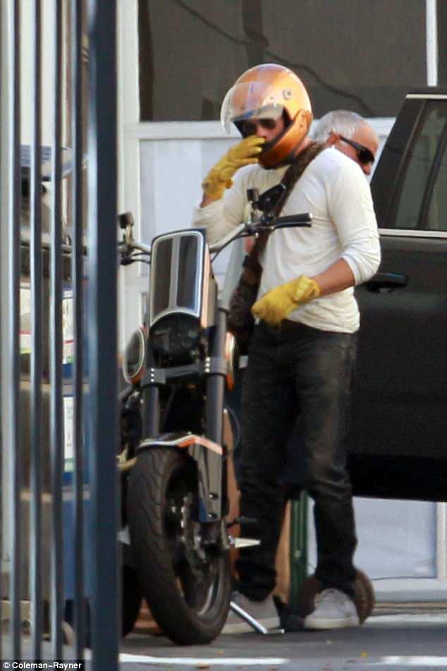 Avoiding traffic: Pitt arrived on his motorbike