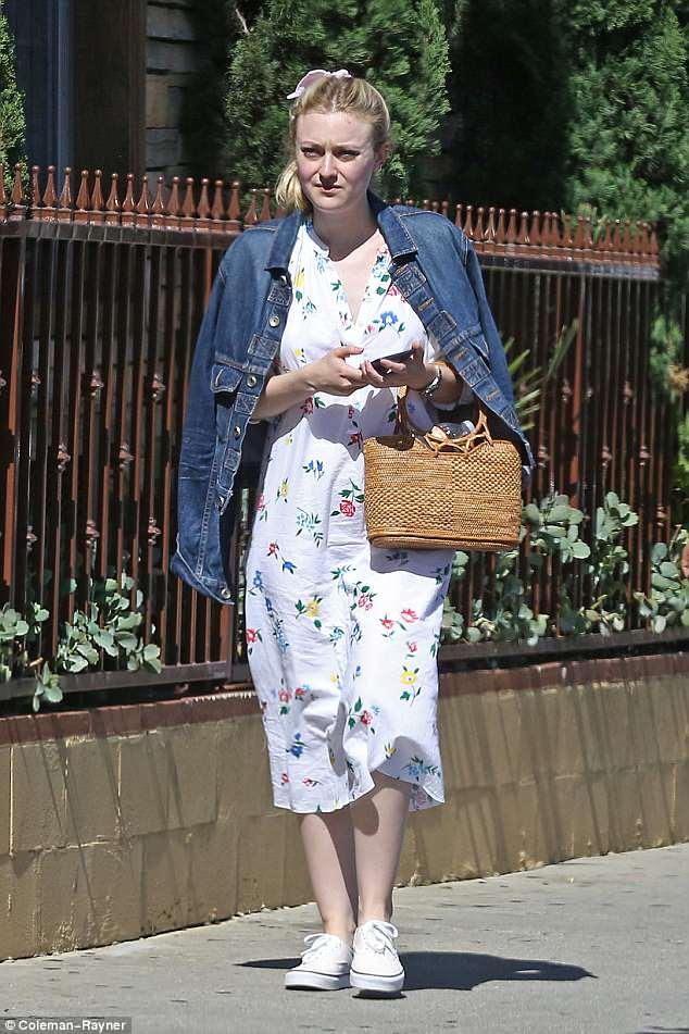 Cute: Dakota Fanning arrived in a cute summer dress and denim jacket