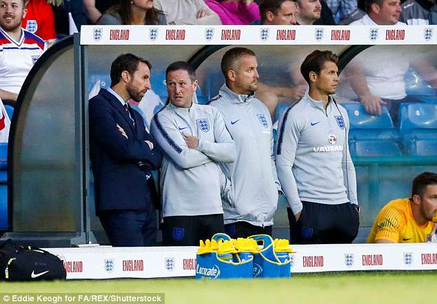 Assistant Steve Holland (2nd left) was seen showing his appreciation towards the goal