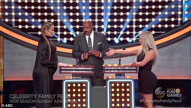 'I see how it is': Kim Kardashian's friendly handshake went rejected by sister Khloe at the start of their Family Feud segment
